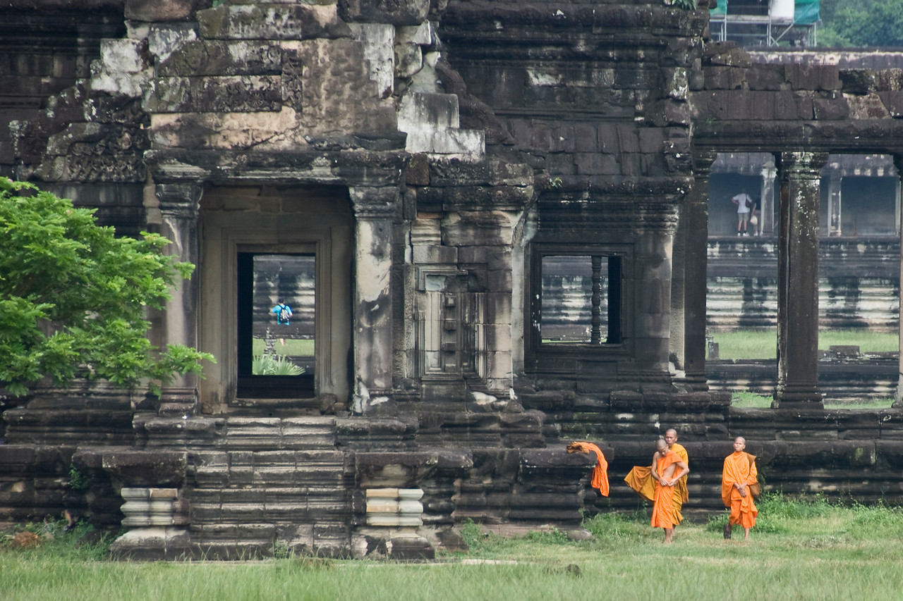 Monks outside the Angkor Wat ruins in Siem Reap, Cambodia