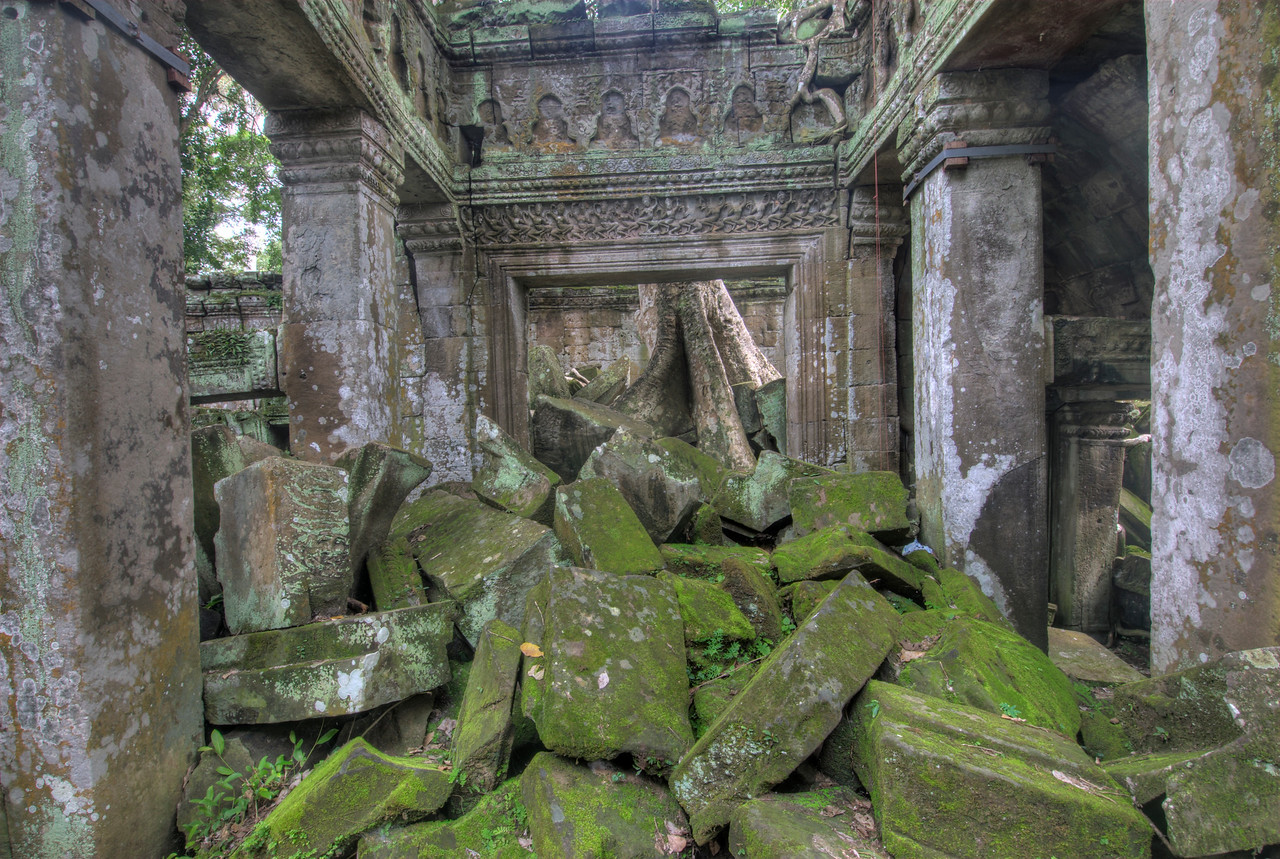 Moss covered stones inside Ta Prohm in Angkor Wat Temple