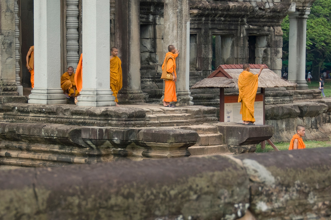 Monks among the ruins of Angkor Wat Temple