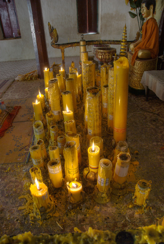 Candles lit at the Wat Atewa Monastery
