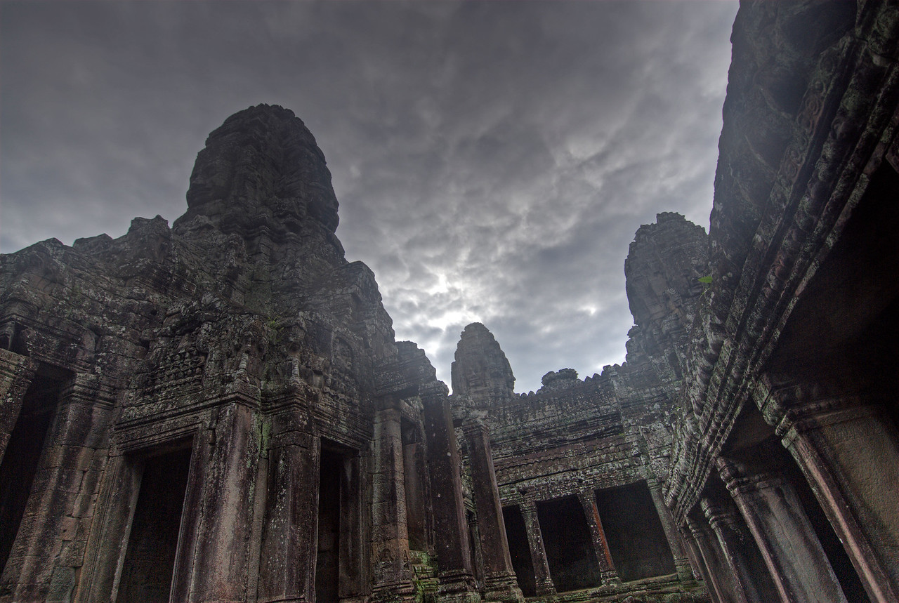 Looking up the dark sky inside Bayon Temple