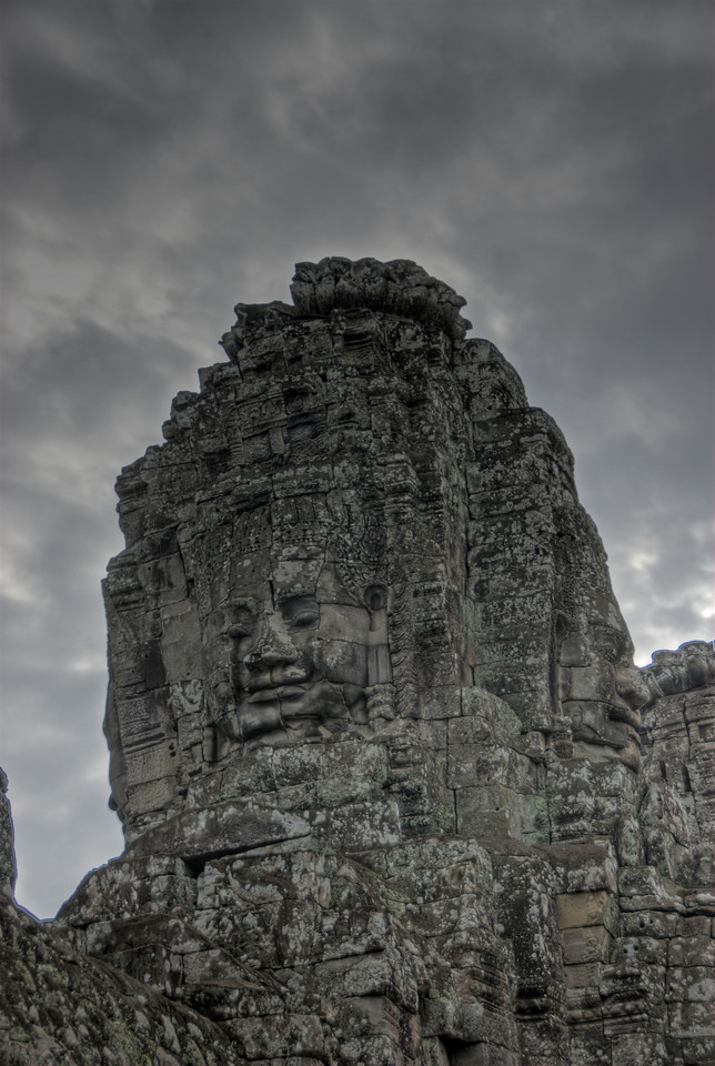 Carved face at a wall in Bayon Temple in Cambodia