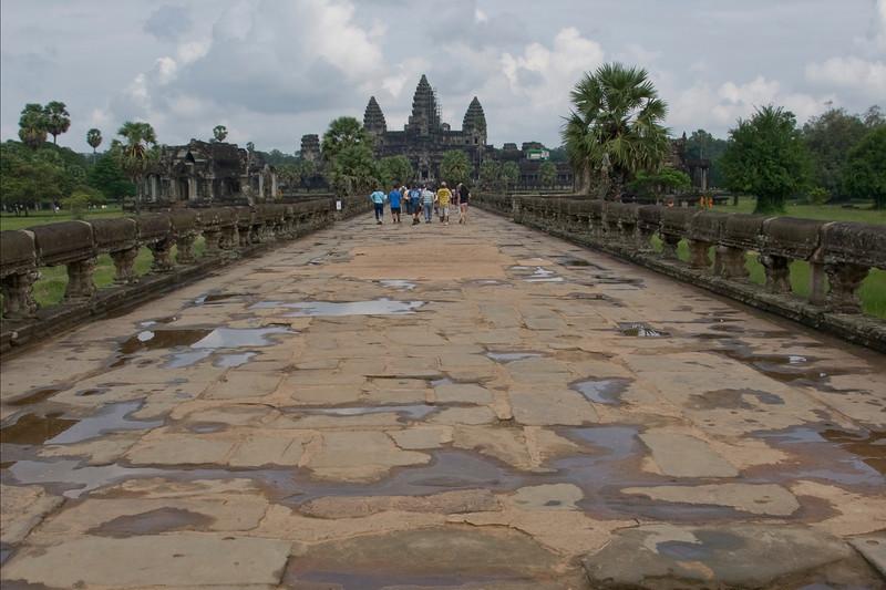 Group of tourists on path to Angkor Wat