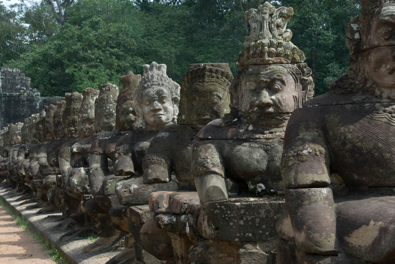 A line of statues along the Angkor Thom Bridge in Cambodia