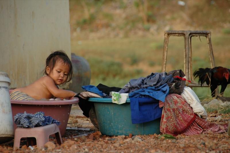 Little Girl in a Bath tub - Battambang, Cambodia