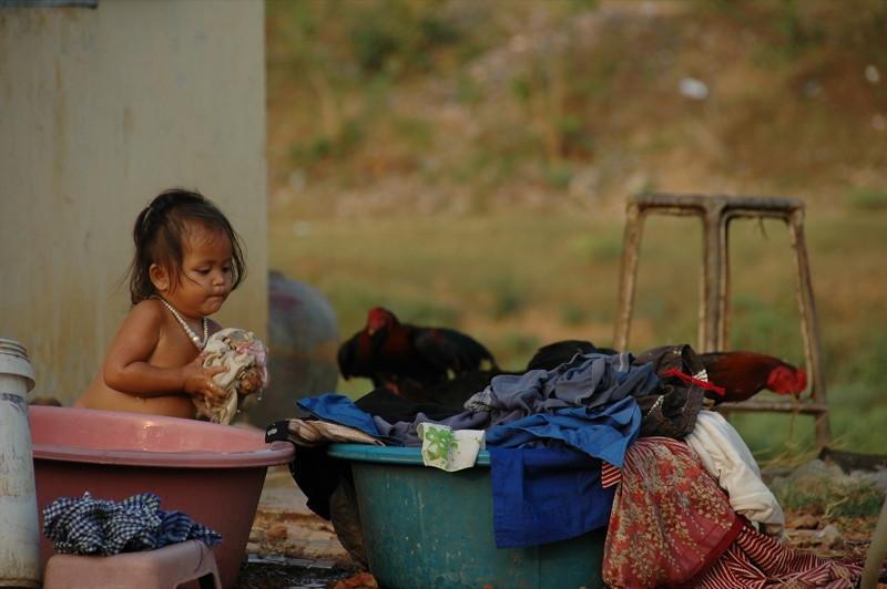Little Girl Rinsing Clothes - Battambang, Cambodia