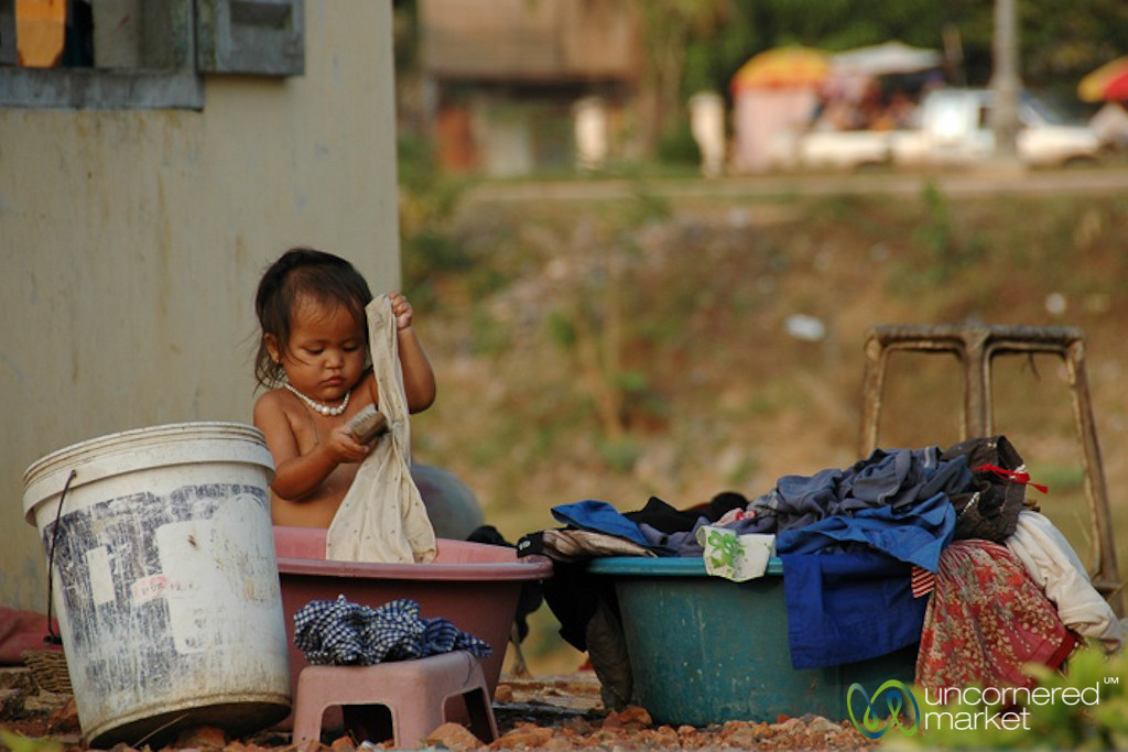 Little Girl Scrubbing Clothes - Battambang, Cambodia