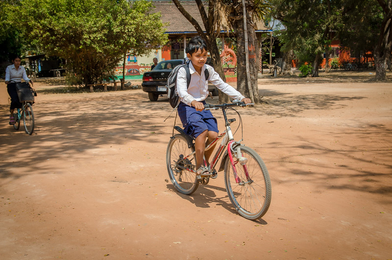 School boy on a bike.