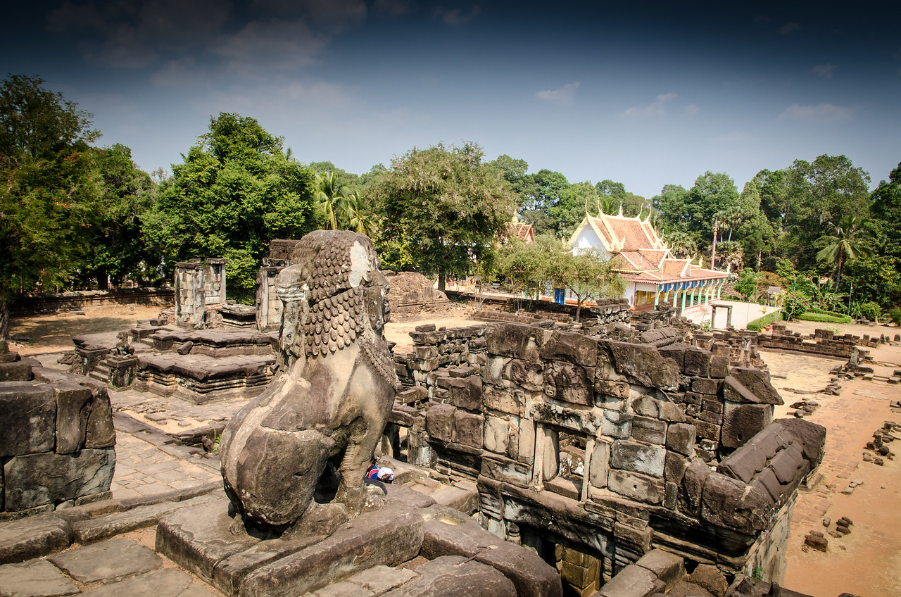 Looking towards a modern temple from the stepped pyramid of Bakong.