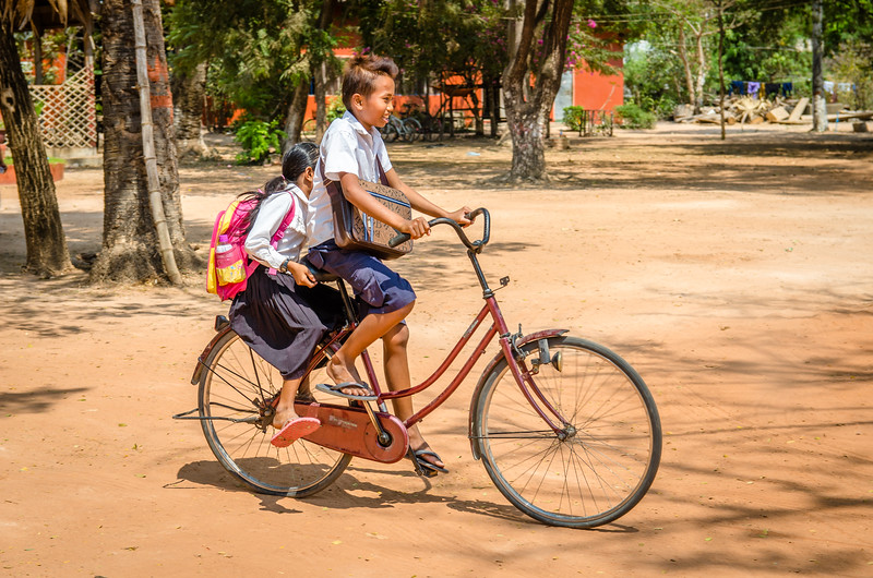 School kids on a bike.