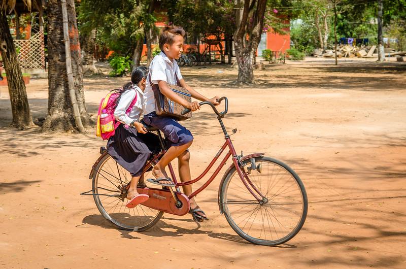 School kids on a bike.
