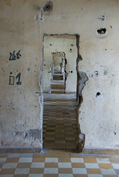 Makeshift doors and walls with graffiti inside Building B in Toule Seng Prison