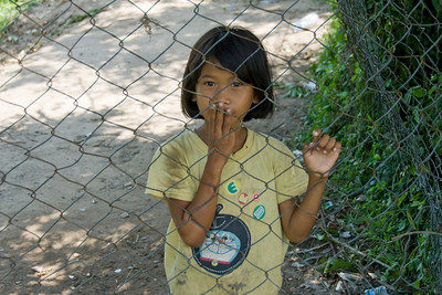 Child near the gate of Killing Fields in Phnom Penh