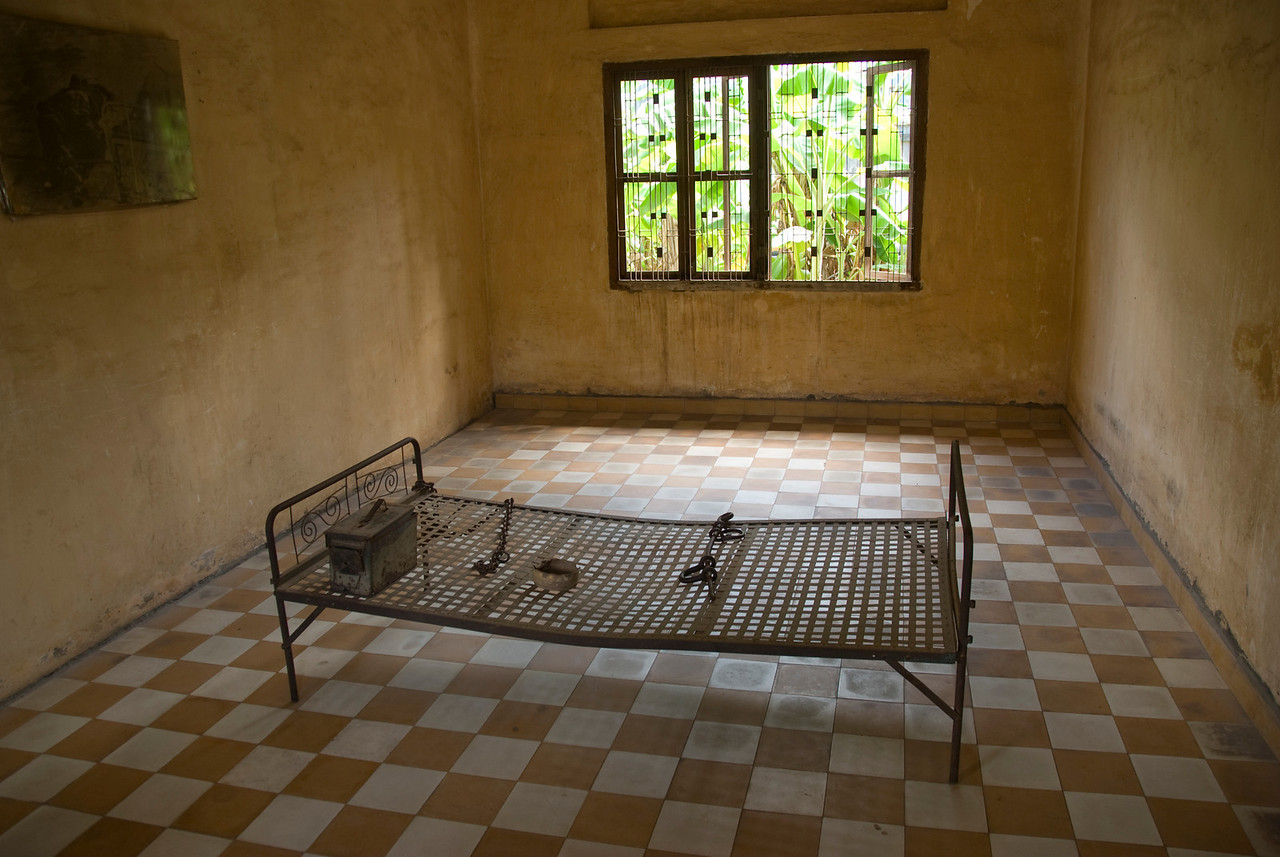 An old prison bed inside a cell in Toule Seng Prison