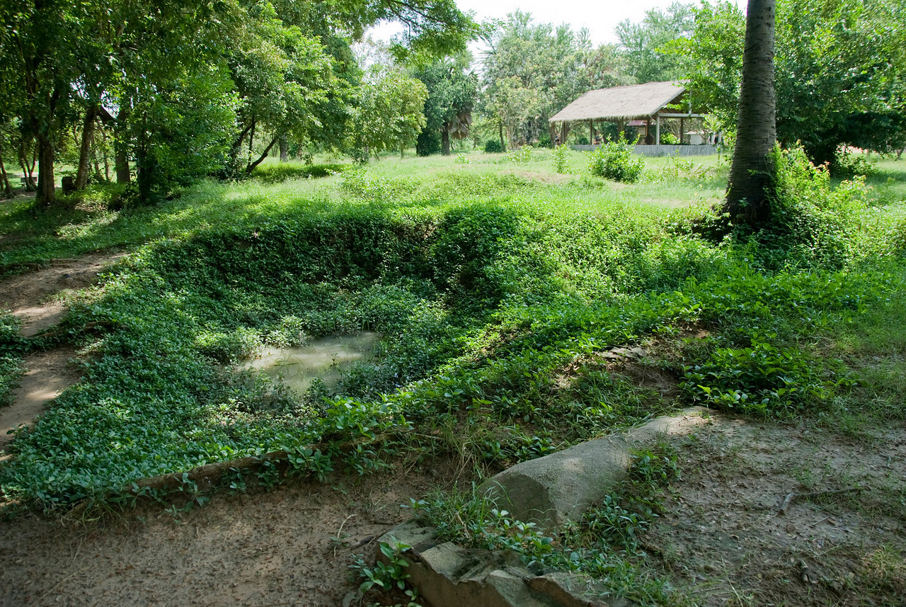 Shallow graves within the Killing Fields in Phnom Penh, Cambodia
