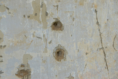 Bullet holes on a wall at Toule Seng Prison in Phnom Penh, Cambodia