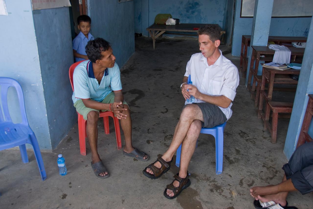 Orphan director at Phnom Penh talking to a local