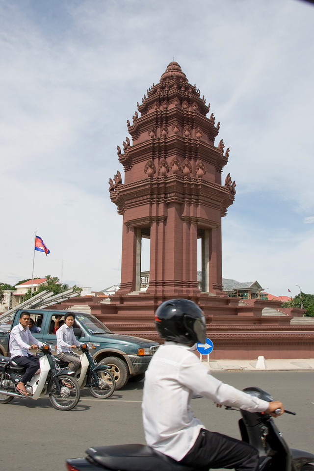 Shot of Democracy monument and commuters in Phnom Penh, Cambodia