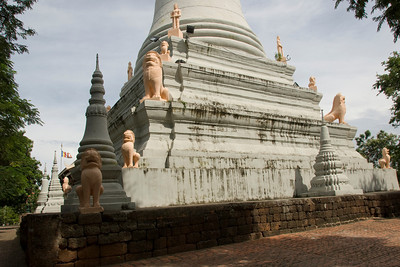 Details of lion statues surrounding Wat Phnom in Cambodia