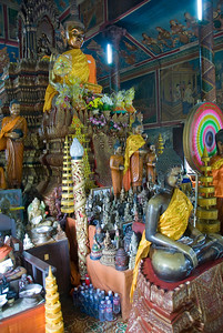 Statues inside Wat Phnom in Phnom Penh, Cambodia