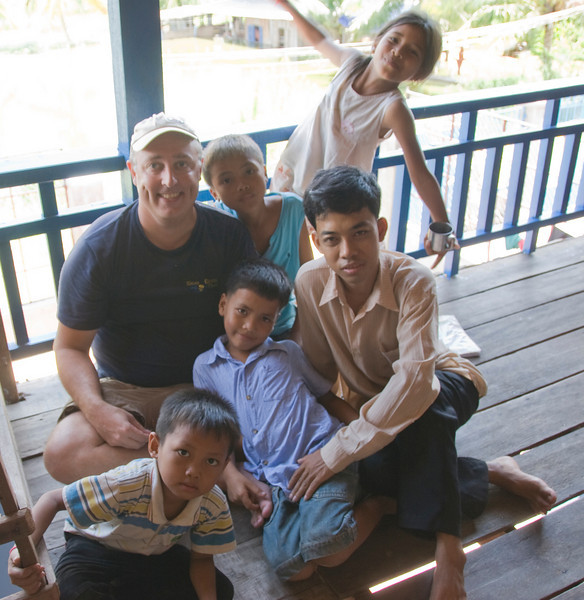 Taking a photo with the orphans in Phnom Penh, Cambodia