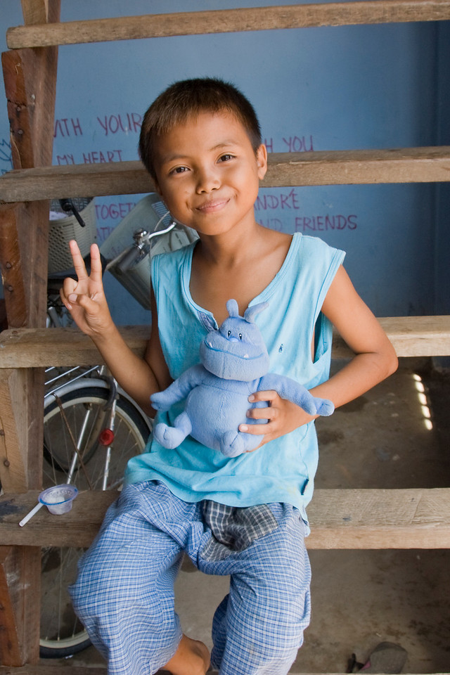 Orphan smiling to the camera at an orphanage in Phnom Penh, Cambodia