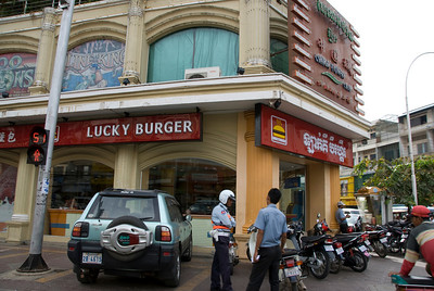 Lucky Burger sign at a street corner in Phnom Penh, Cambodia