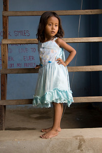 Barefoot orphan girl inside the orphanage in Phnom Penh, Cambodia