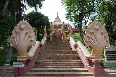 Stairs with statue leading to the entrance of Wat Phnom in Cambodia