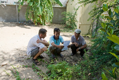 Working out a deal with locals in Phnom Penh, Cambodia
