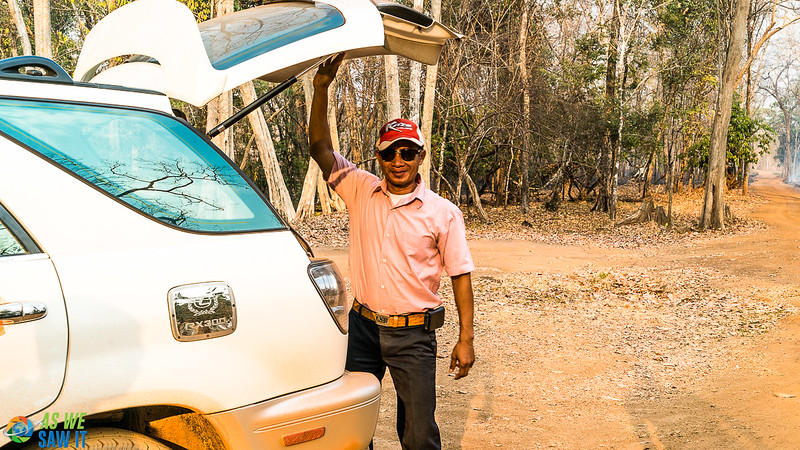 Sunny, our siem reap tour guide, stands at the open back of his Lexus. Time for a cool towel and some water!