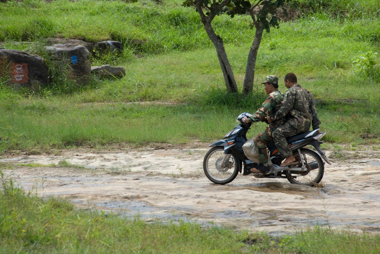 Soldiers riding on motorcycles outside of the Preah Vihear Temple
