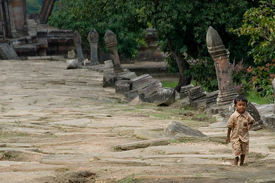 Barefoot child walking inside the Preah Vihear Temple