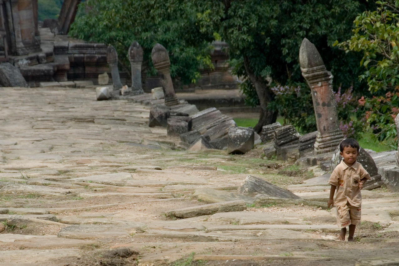 Barefoot child walking inside the Preah Vihear Temple