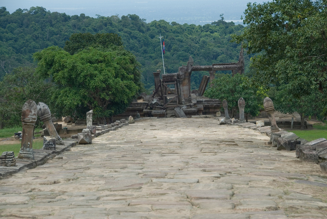 Path showing old structure with flag in Preah Vihear Temple