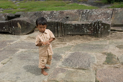 Barefoot child inside Preah Vihear Temple