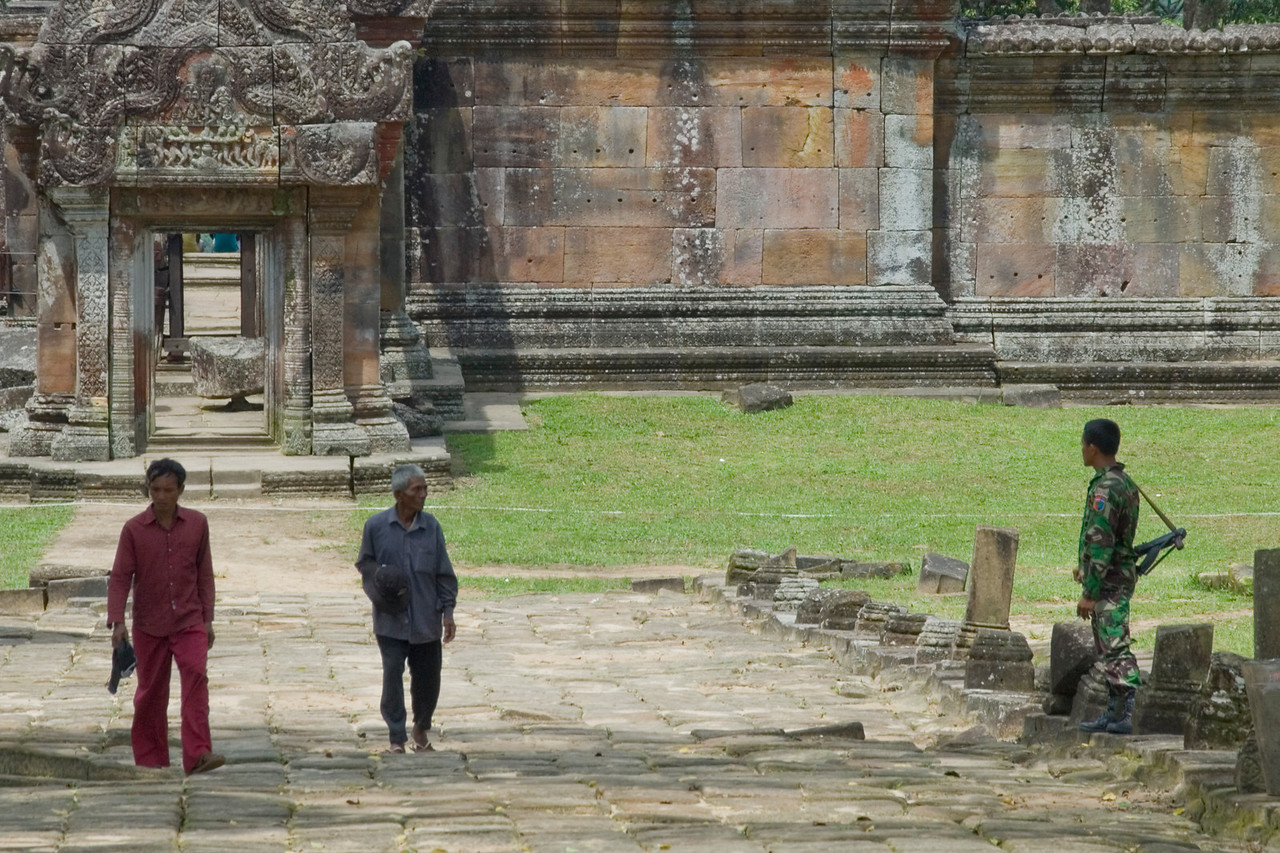 Locals and a soldier on guard outside of the Preah Vihear Temple grounds