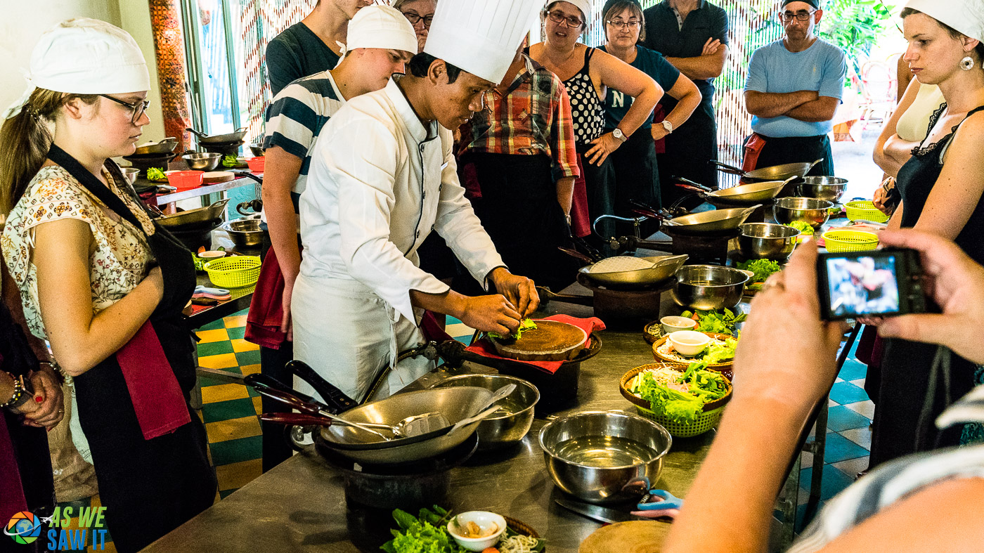 students gathered around the instructor at a cooking school in Siem Reap