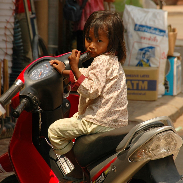 Child Waiting on a Motorbike - Siem Reap, Cambodia