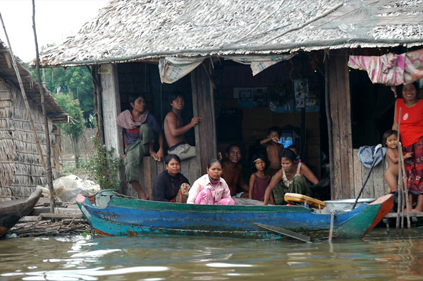 People Watching TV in Floating House - Battambang, Cambodia