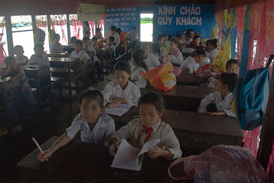 Students inside a floating Vietnamese school in Tonle Sap, Cambodia