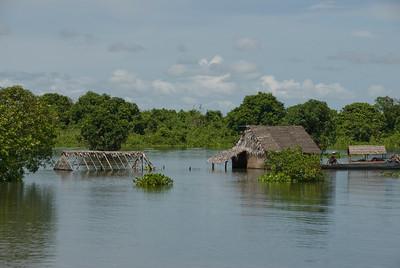 A sunken hut near water village in Tonle Sap, Cambodia