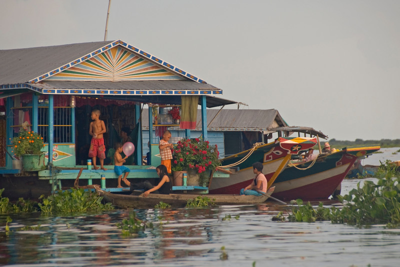 Shot of a family in one of the floating houses in Tonle Sap