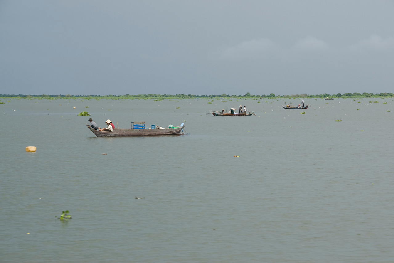 Three fishing boats docked in the middle of Tonle Sap in Cambodia