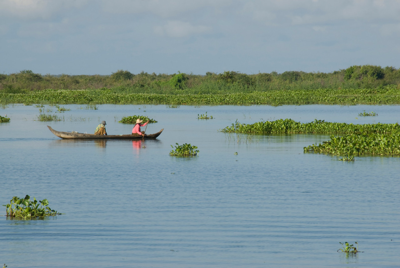 Two women fishing in the morning at Tonle Sap, Cambodia