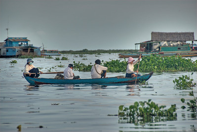 Students rowing home from school in Tonle Sap, Cambodia