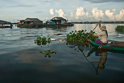 Students coming home from school on a boat in Tonle Sap