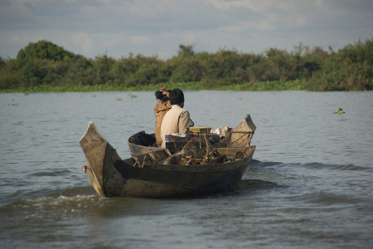 Couple with two boats in Tonle Sap, Cambodia