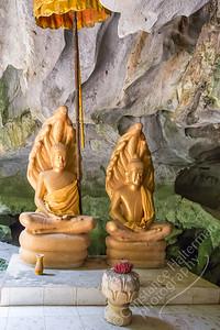 Cave shrine - Naga Buddhas