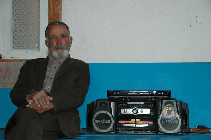 Pamiri Man and Boom Box - Khorog, Tajikistan